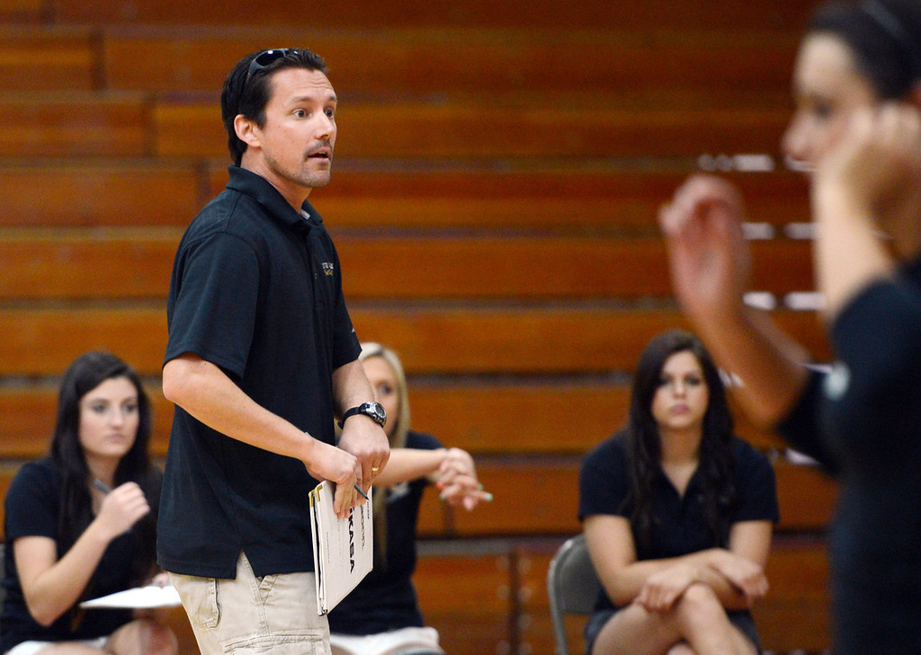 Description of . Butte College coach Dave Davis looks on against Chico State in their volleyball game at CSUC Acker Gym Saturday, August 24, 2013 in Chico, Calif.  (Jason Halley/Chico Enterprise-Record)