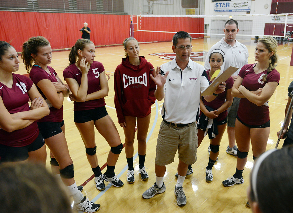 Description of . Chico State coach Cody Hein (center) talks to the team against Butte College in their volleyball game at CSUC Acker Gym Saturday, August 24, 2013 in Chico, Calif.  (Jason Halley/Chico Enterprise-Record)