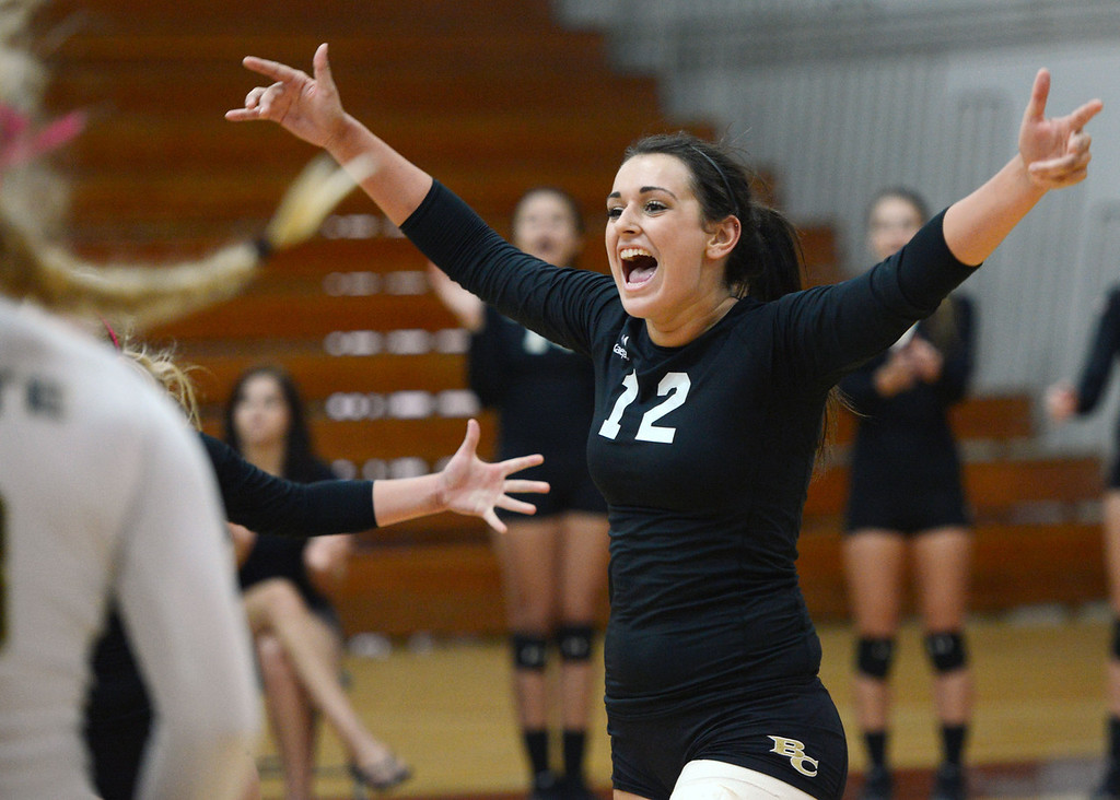 Description of . Butte College's #12 Callie Flood reacts to a score against Chico State in their volleyball game at CSUC Acker Gym Saturday, August 24, 2013 in Chico, Calif.  (Jason Halley/Chico Enterprise-Record)