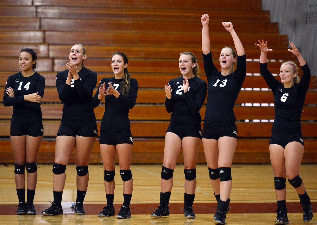 Description of . Butte College's #14 Gabby Delarosa, #20 Erika Click, #7 Taylor Johnson, #21 Drew Tattam, #13 Emilie Aase and #6 Lacie Landrum (left to right) react to a score against Chico State in their volleyball game at CSUC Acker Gym Saturday, August 24, 2013 in Chico, Calif.  (Jason Halley/Chico Enterprise-Record)