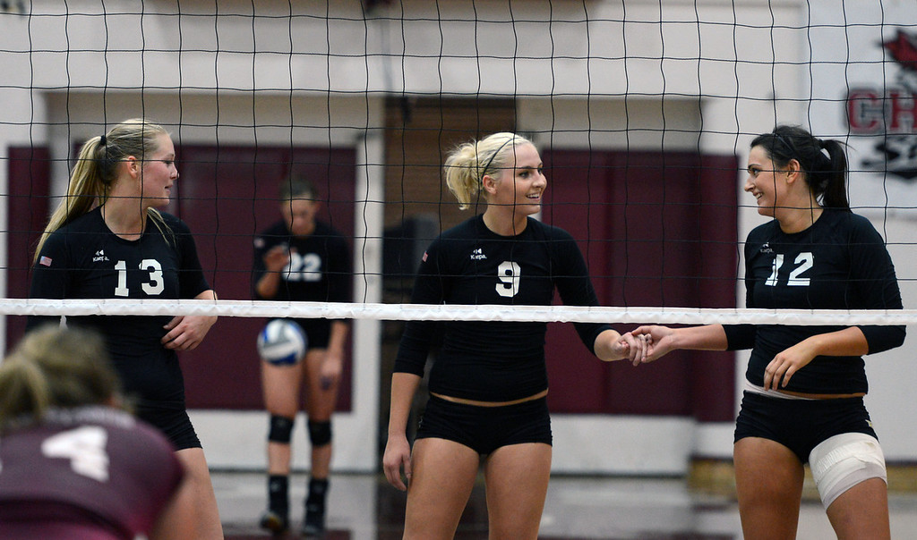 Description of . Butte College's #13 Emilie Aase, #9 Colleen Tade, and #12 Callie Flood (left to right) ready against Chico State in their volleyball game at CSUC Acker Gym Saturday, August 24, 2013 in Chico, Calif.  (Jason Halley/Chico Enterprise-Record)