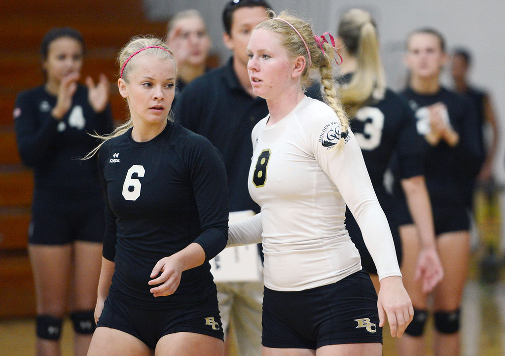 Description of . Butte College' #6 Lacie Landrum (left) and #8 Mikaela Woodbury (right) ready against Chico State in their volleyball game at CSUC Acker Gym Saturday, August 24, 2013 in Chico, Calif.  (Jason Halley/Chico Enterprise-Record)
