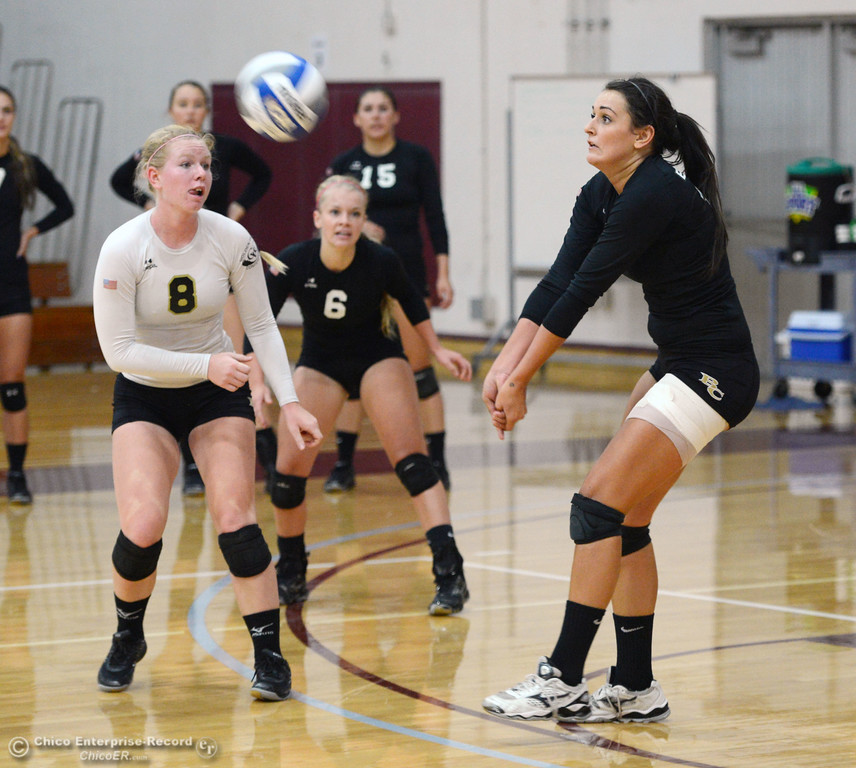 Description of . Butte College's #8 Mikaela Woodbury (left) and #6 Lacie Landrum (center) watch #12 Callie Flood (right) hit against Chico State in their volleyball game at CSUC Acker Gym Saturday, August 24, 2013 in Chico, Calif.  (Jason Halley/Chico Enterprise-Record)