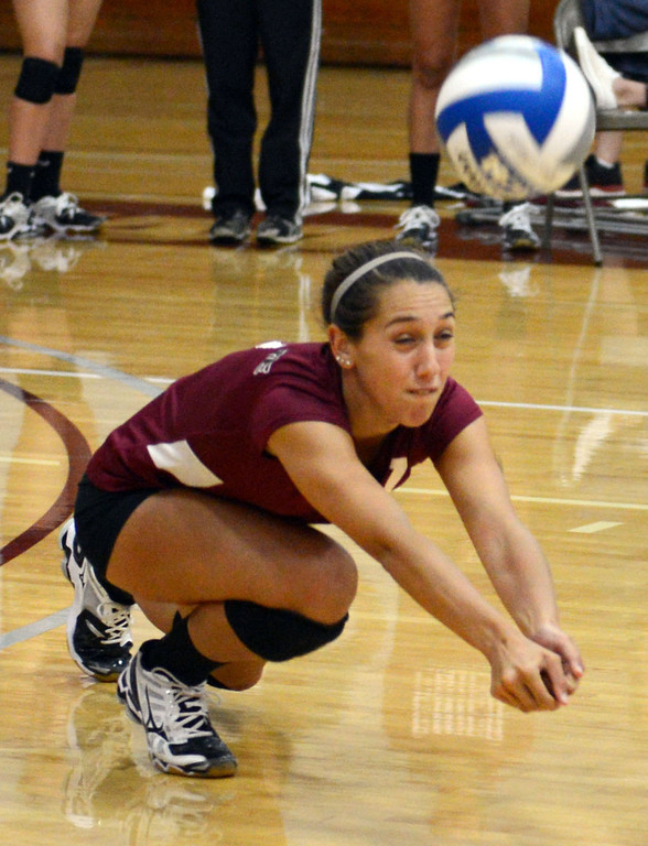 Description of . Chico State's #7 Shannon Cotton dives for a dig against Butte College in their volleyball game at CSUC Acker Gym Saturday, August 24, 2013 in Chico, Calif.  (Jason Halley/Chico Enterprise-Record)