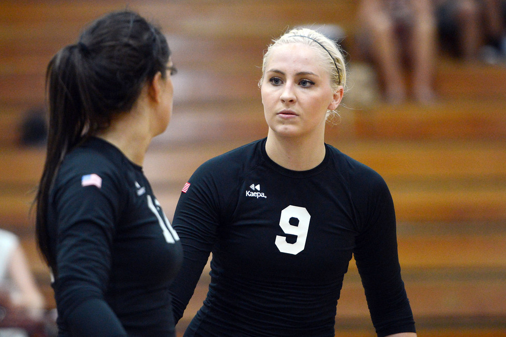 Description of . Butte College's #12 Callie Flood (left) and #9 Colleen Tade (right) ready against Chico State in their volleyball game at CSUC Acker Gym Saturday, August 24, 2013 in Chico, Calif.  (Jason Halley/Chico Enterprise-Record)