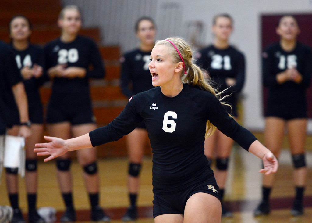 Description of . Butte College's #6 Lacie Landrum reacts to a score against Chico State in their volleyball game at CSUC Acker Gym Saturday, August 24, 2013 in Chico, Calif.  (Jason Halley/Chico Enterprise-Record)