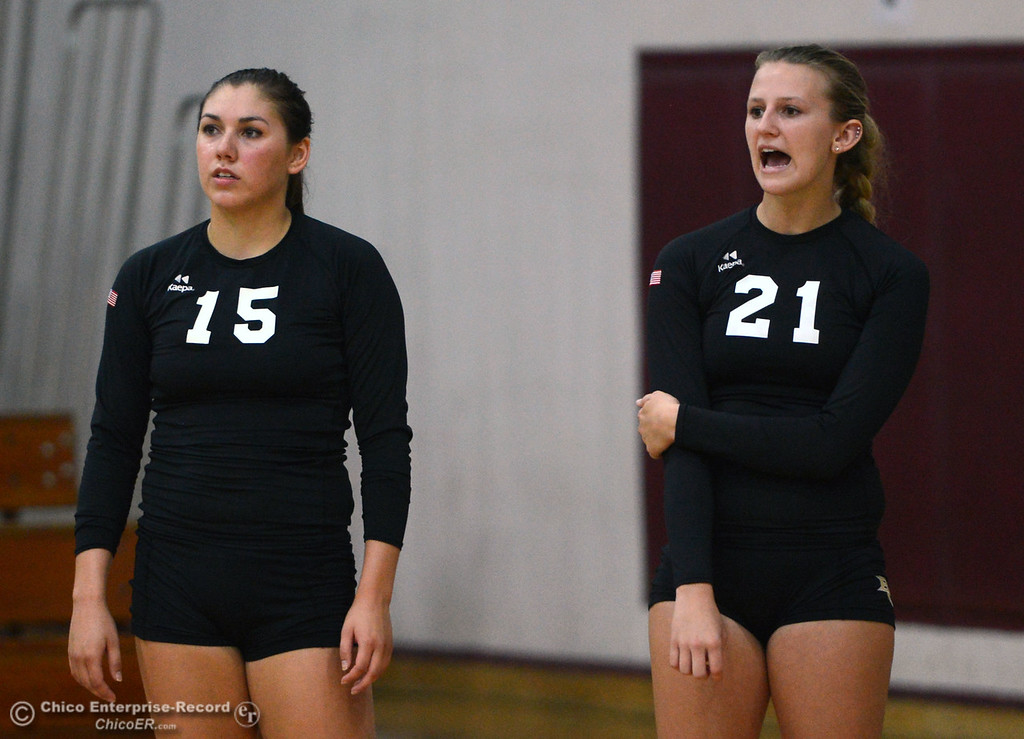 Description of . Butte College's #15 Kristen Keys (left) and #21 Drew Tattam (right) look on against Chico State in their volleyball game at CSUC Acker Gym Saturday, August 24, 2013 in Chico, Calif.  (Jason Halley/Chico Enterprise-Record)