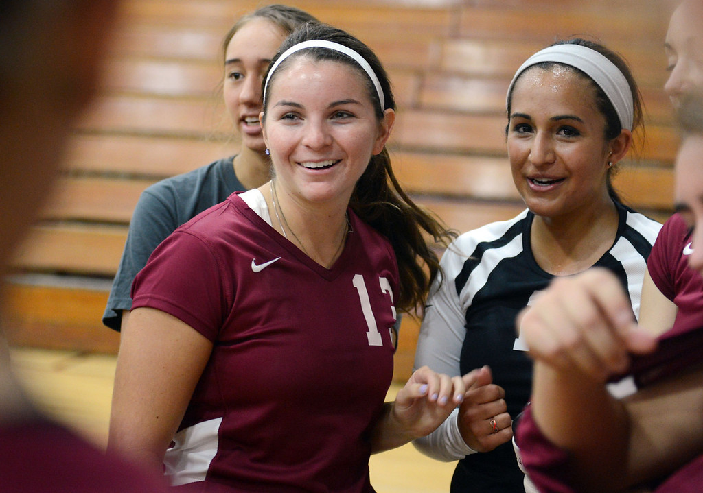 Description of . Chico State's #13 Emily Duran (left) and #11 Lauren Orozco (right) during a timeout against Butte College in their volleyball game at CSUC Acker Gym Saturday, August 24, 2013 in Chico, Calif.  (Jason Halley/Chico Enterprise-Record)