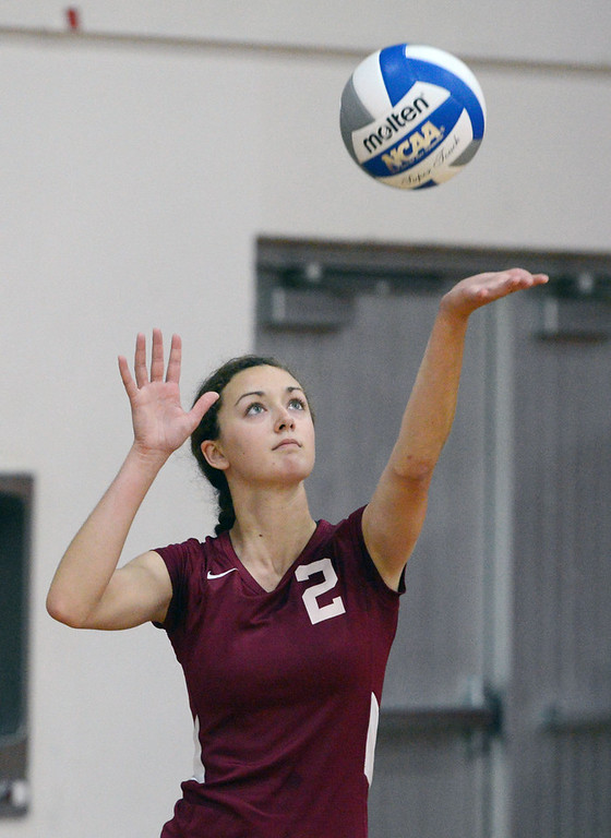 Description of . Butte College against Chico State's #2 Ellie Larronde serves in their volleyball game at CSUC Acker Gym Saturday, August 24, 2013 in Chico, Calif.  (Jason Halley/Chico Enterprise-Record)