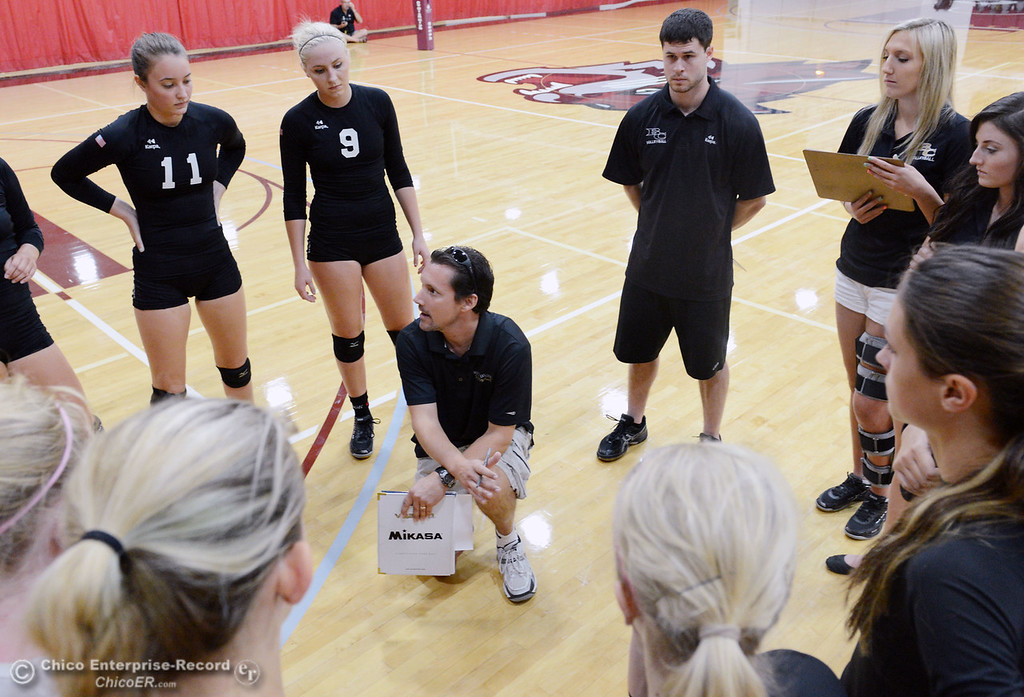 Description of . Butte College coach Dave Davis (center) talks to the team as they play against Chico State in their volleyball game at CSUC Acker Gym Saturday, August 24, 2013 in Chico, Calif.  (Jason Halley/Chico Enterprise-Record)