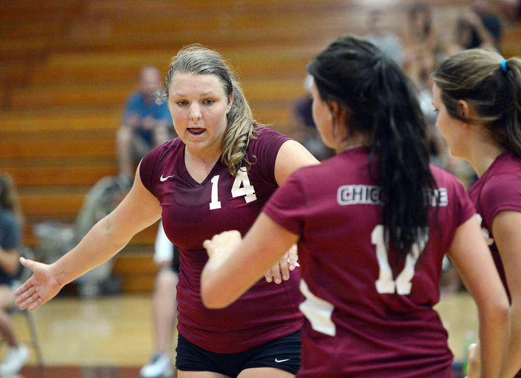 Description of . Chico State's #14 Alex Shurtz readies against Butte College in their volleyball game at CSUC Acker Gym Saturday, August 24, 2013 in Chico, Calif.  (Jason Halley/Chico Enterprise-Record)