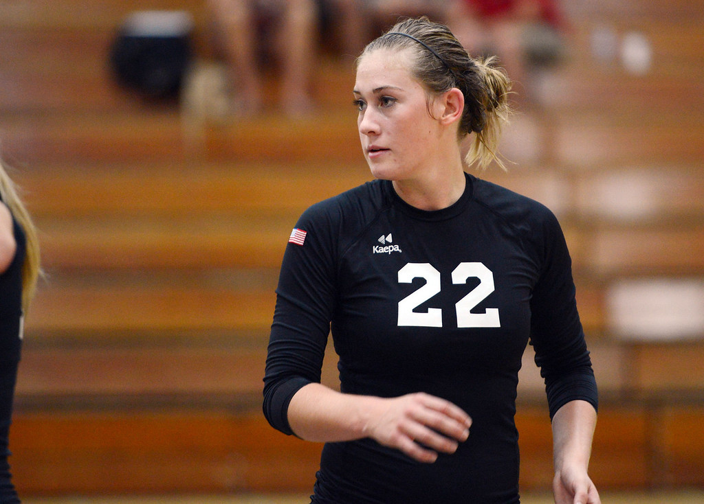 Description of . Butte College' #22 Courtney Robinson readies against Chico State in their volleyball game at CSUC Acker Gym Saturday, August 24, 2013 in Chico, Calif.  (Jason Halley/Chico Enterprise-Record)