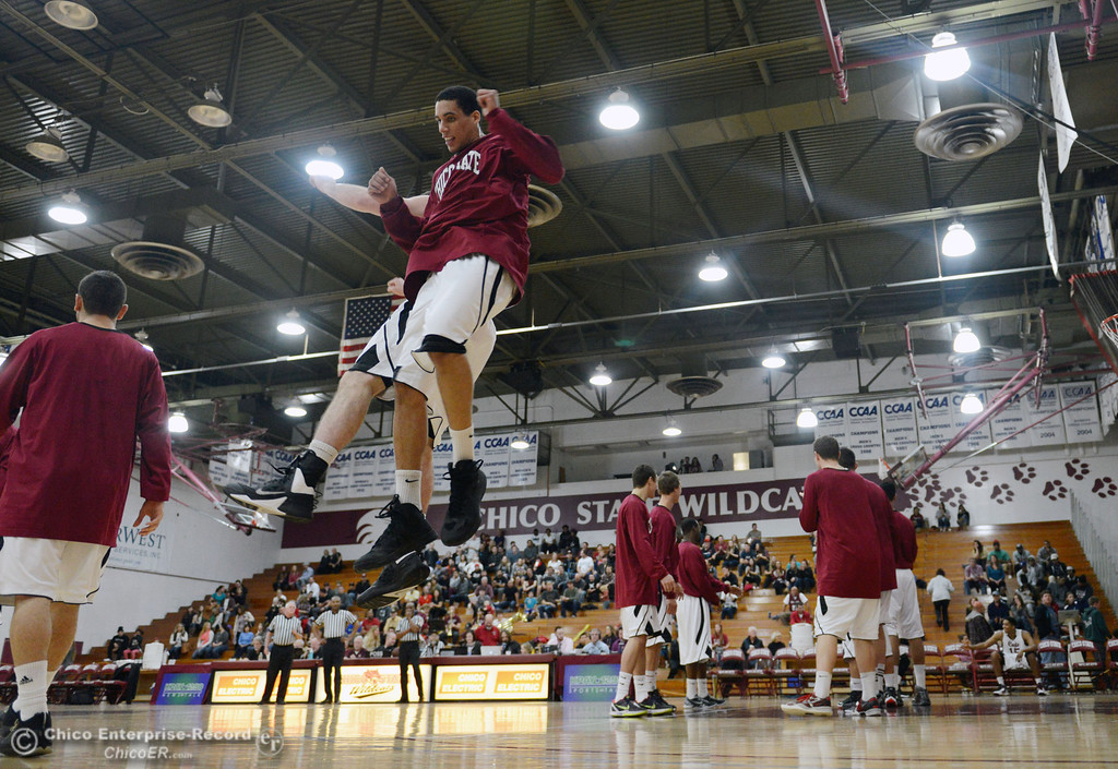 Description of . Chico State\'s #45 Jordan Semple (center) leaps in the air to greet the team against Cal State Dominguez Hills in the first half of their men\'s basketball game at CSUC Acker Gym Friday, January 10, 2014 in Chico, Calif.  (Jason Halley/Chico Enterprise-Record)