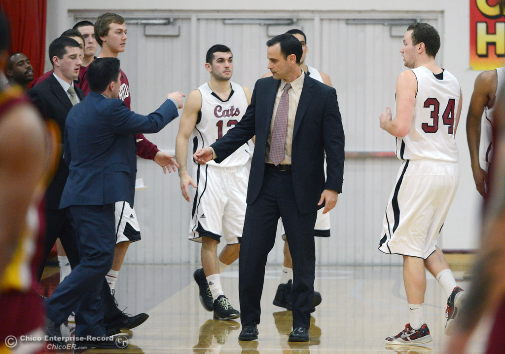 Description of . Chico State head coach Greg Clink takes a timeout against Cal State Dominguez Hills in the first half of their men\'s basketball game at CSUC Acker Gym Friday, January 10, 2014 in Chico, Calif.  (Jason Halley/Chico Enterprise-Record)