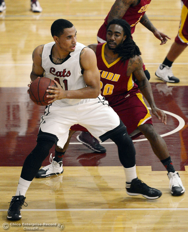 Description of . Chico State\'s #41 Jordan Barton (left) dribbles against Cal State Dominguez Hills\' #20 Steffon Neal (right) in the first half of their men\'s basketball game at CSUC Acker Gym Friday, January 10, 2014 in Chico, Calif.  (Jason Halley/Chico Enterprise-Record)