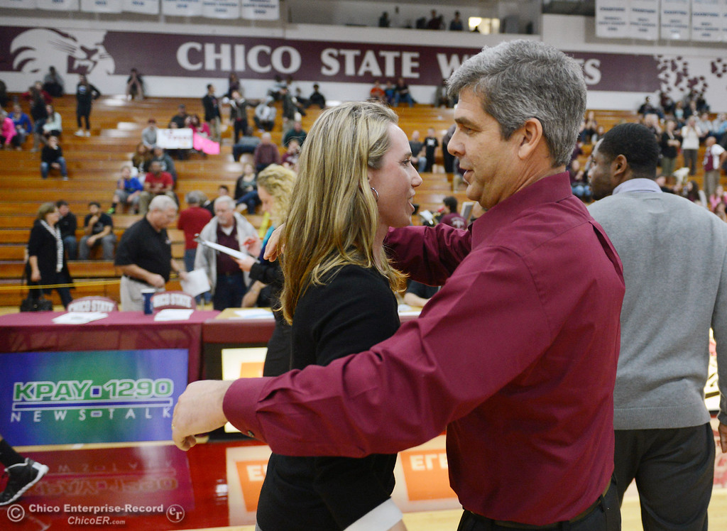 Description of . Former Chico State coach and current Cal State Dominguez Hills\' head coach Molly Goodenbour (left) hugs Chico State head coach Brian Fogel (right) after their women\'s basketball game at CSUC Acker Gym Friday, January 10, 2014 in Chico, Calif.  (Jason Halley/Chico Enterprise-Record)