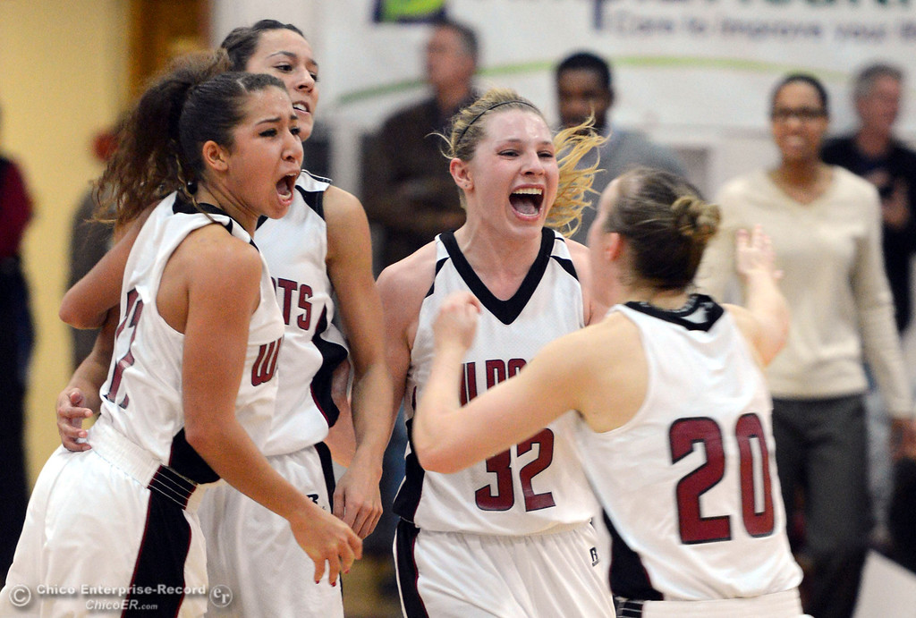 Description of . Chico State\'s #11 Hannah Womack, #21 Courtney Hamilton, #32 Michelle Walker, and #20 Annie Ward (left to right) celebrate their win against Cal State Dominguez Hills in the second half of their women\'s basketball game at CSUC Acker Gym Friday, January 10, 2014 in Chico, Calif.  (Jason Halley/Chico Enterprise-Record)