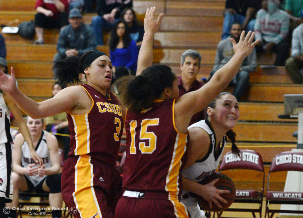 Description of . Chico State\'s #30 McKenzie Dalthorp (right) goes up for a shot against Cal State Dominguez Hills\' #15 Monay Lee (center) and #3 Tayler Champion (left) in the second half of their women\'s basketball game at CSUC Acker Gym Friday, January 10, 2014 in Chico, Calif.  (Jason Halley/Chico Enterprise-Record)