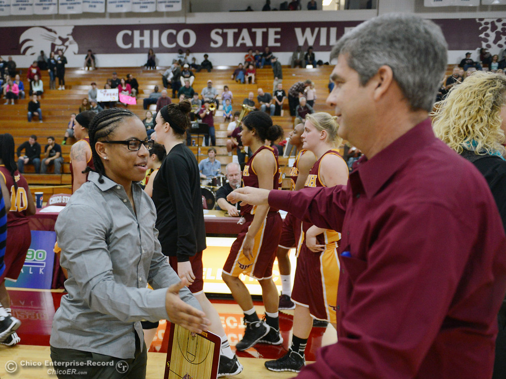 Description of . Former Chico State player and current Cal State Dominguez Hills\' assistant coach Natasha Smith (left) hugs Chico State head coach Brian Fogel (right) after their women\'s basketball game at CSUC Acker Gym Friday, January 10, 2014 in Chico, Calif.  (Jason Halley/Chico Enterprise-Record)