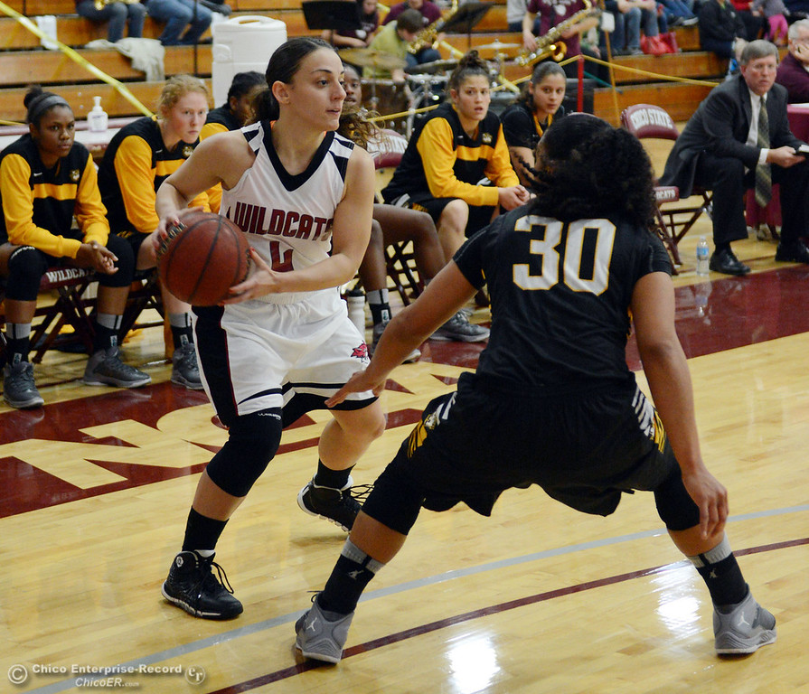 Description of . Chico State\'s #4 Sarah Rebibo (left) dribbles against Cal State L.A.\'s #30 Kaija Powell (right) in the first half of their women\'s basketball game at CSUC Acker Gym Saturday, January 11, 2014 in Chico, Calif.  (Jason Halley/Chico Enterprise-Record)