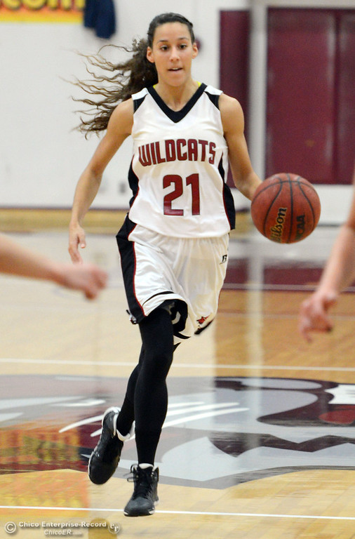 Description of . Chico State\'s #21 Courtney Hamilton dribbles against Cal State L.A. in the first half of their women\'s basketball game at CSUC Acker Gym Saturday, January 11, 2014 in Chico, Calif.  (Jason Halley/Chico Enterprise-Record)