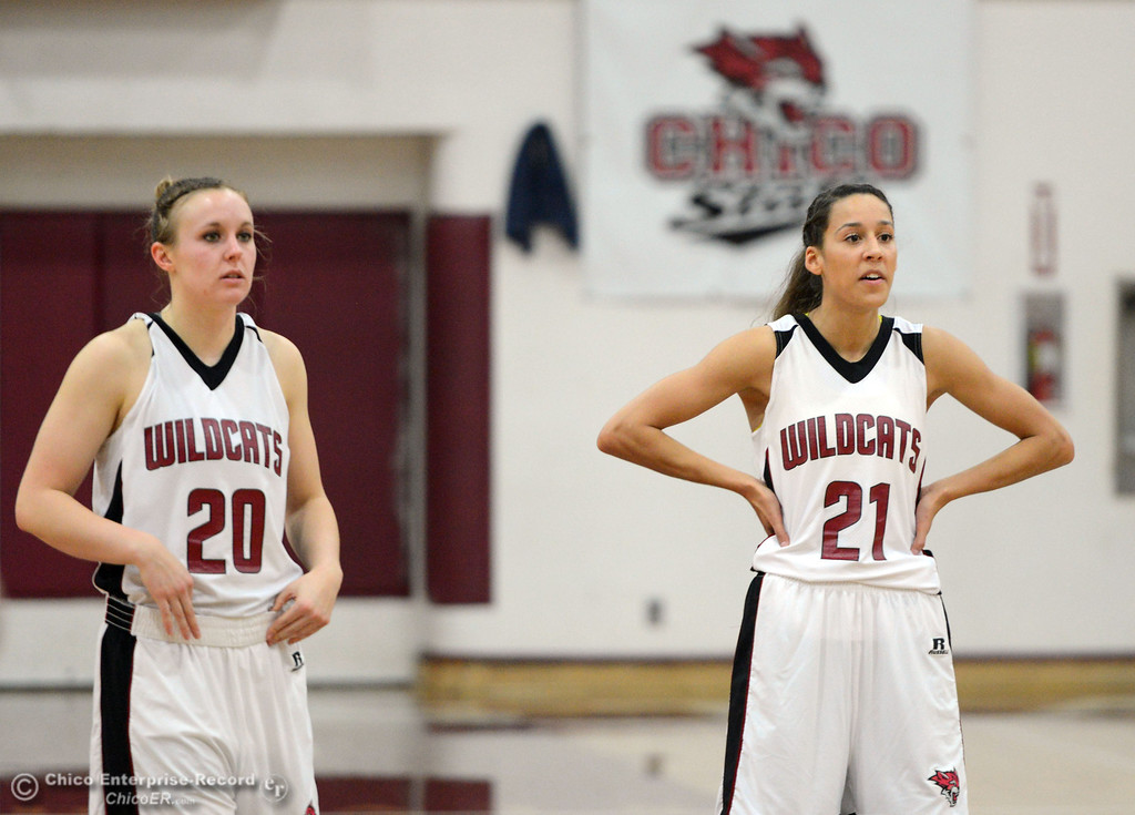 Description of . Chico State\'s #20 Annie Ward (left) and #21 Courtney Hamilton (right) look on against Cal State L.A. in the first half of their women\'s basketball game at CSUC Acker Gym Saturday, January 11, 2014 in Chico, Calif.  (Jason Halley/Chico Enterprise-Record)