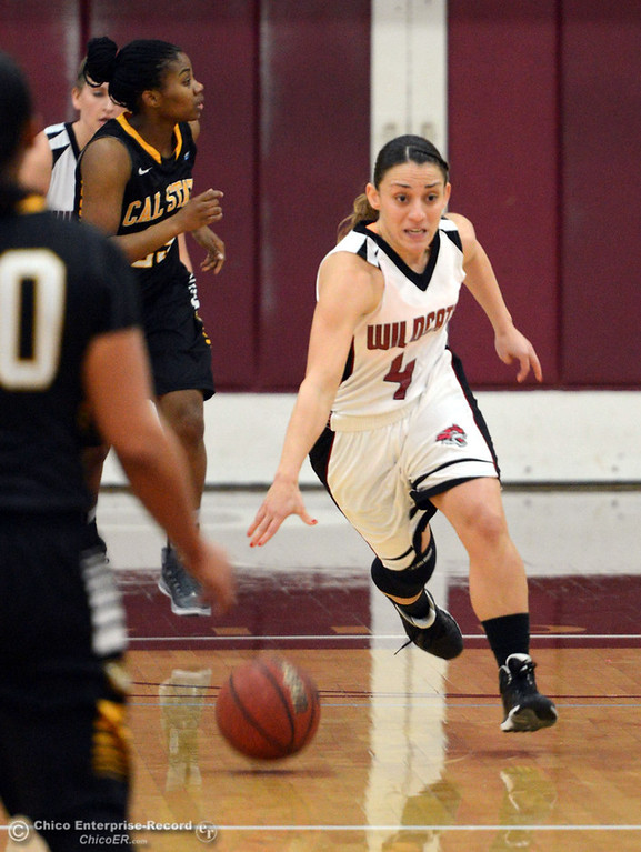Description of . Chico State\'s #4 Sarah Rebibo dribbles against Cal State L.A. in the first half of their women\'s basketball game at CSUC Acker Gym Saturday, January 11, 2014 in Chico, Calif.  (Jason Halley/Chico Enterprise-Record)
