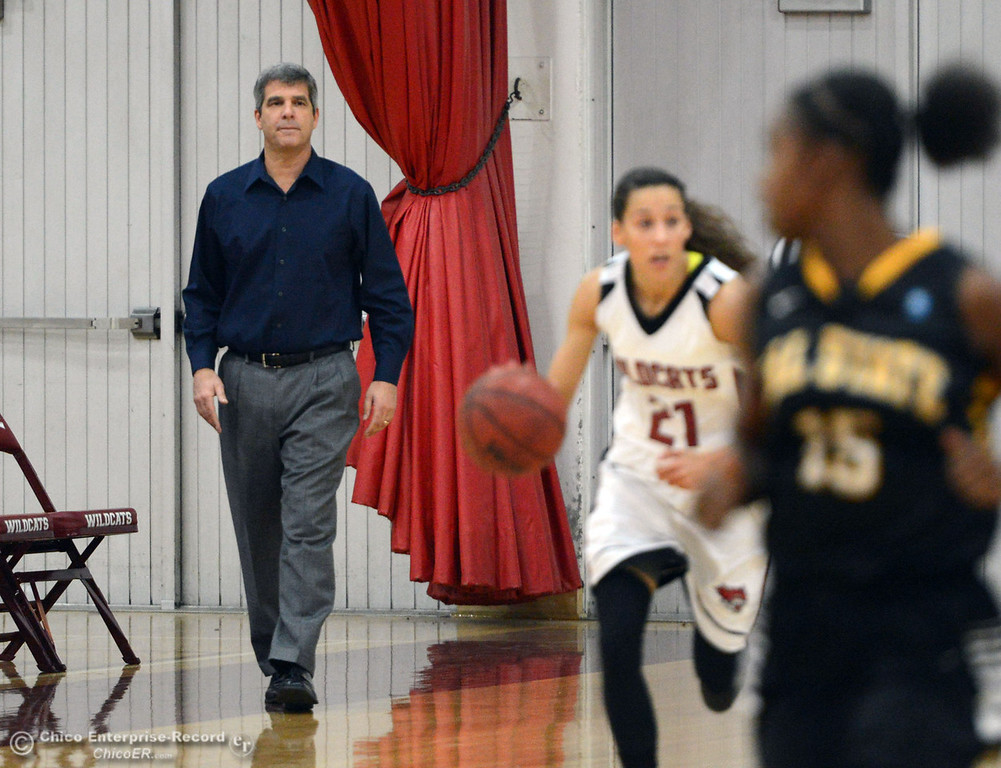 Description of . Chico State\'s head coach Brian Fogel (left) looks on against Cal State L.A. in the first half of their women\'s basketball game at CSUC Acker Gym Saturday, January 11, 2014 in Chico, Calif.  (Jason Halley/Chico Enterprise-Record)