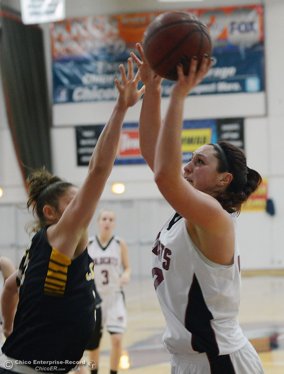 Description of . Chico State\'s #30 McKenzie Dalthorp (right) goes up for a shot against Cal State L.A.\'s #33 Richelle Najera (left) in the first half of their women\'s basketball game at CSUC Acker Gym Saturday, January 11, 2014 in Chico, Calif.  (Jason Halley/Chico Enterprise-Record)