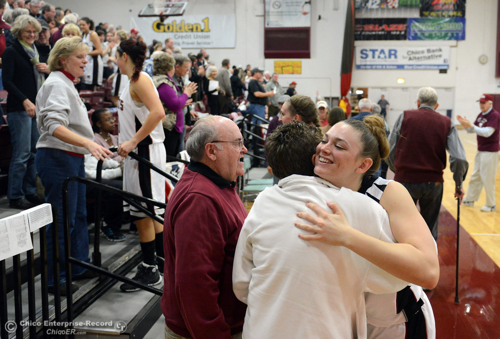 Description of . Chico State\'s #33 Ashtyn Anderson (right) hugs fans that came out to see their women\'s basketball game against Cal State L.A. at CSUC Acker Gym Saturday, January 11, 2014 in Chico, Calif.  (Jason Halley/Chico Enterprise-Record)