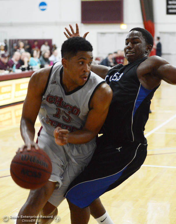 . Chico State\'s #15 Amir Carraway (left) dribbles against Cal State San Bernardino\'s #1 Kirby Gardner (right) in the first half of their men\'s basketball game at CSUC Acker Gym Saturday, February 8, 2014 in Chico, Calif.  (Jason Halley/Chico Enterprise-Record)