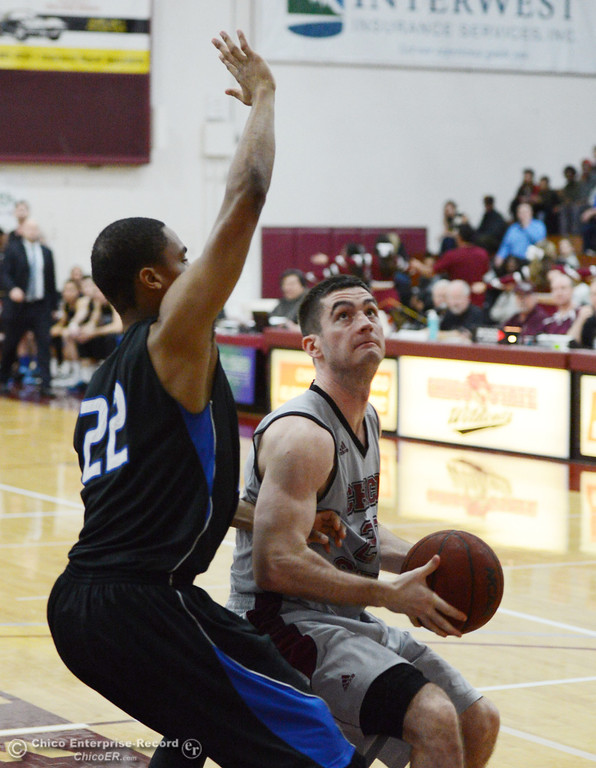 . Chico State\'s #20 Sean Park (right) dribbles against Cal State San Bernardino\'s #22 Joshua Gouch (left) in the second half of their men\'s basketball game at CSUC Acker Gym Saturday, February 8, 2014 in Chico, Calif.  (Jason Halley/Chico Enterprise-Record)
