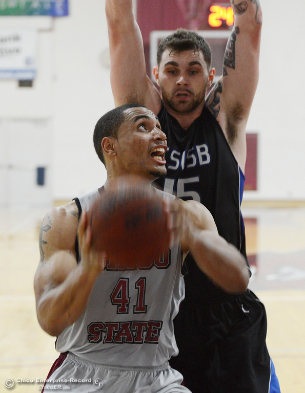 . Chico State\'s #41 Jordan Barton (bottom) goes up for a shot against Cal State San Bernardino\'s #15 Andrew Young (top) in the second half of their men\'s basketball game at CSUC Acker Gym Saturday, February 8, 2014 in Chico, Calif.  (Jason Halley/Chico Enterprise-Record)