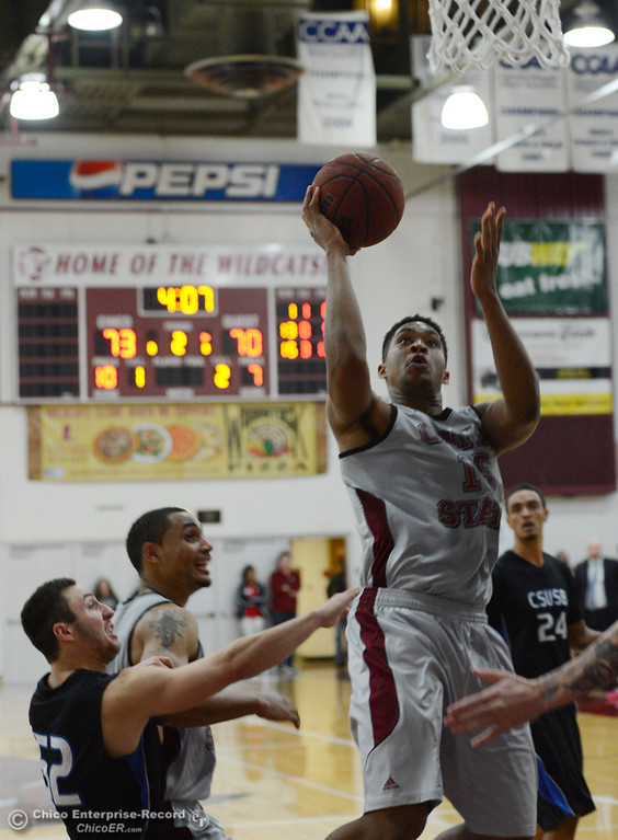 . Chico State\'s #15 Amir Carraway (right) goes up for a shot against Cal State San Bernardino in overtime of their men\'s basketball game at CSUC Acker Gym Saturday, February 8, 2014 in Chico, Calif.  (Jason Halley/Chico Enterprise-Record)