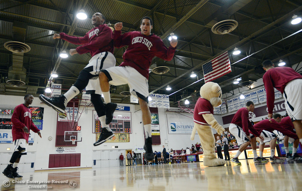 Description of . Chico State's #41 Jordan Barton (left) and #45 Jordan Semple (right) leap in the air to start against UC San Diego in the first half of their men's basketball game at CSUC Acker Gym Friday, February 7, 2014 in Chico, Calif.  (Jason Halley/Chico Enterprise-Record)