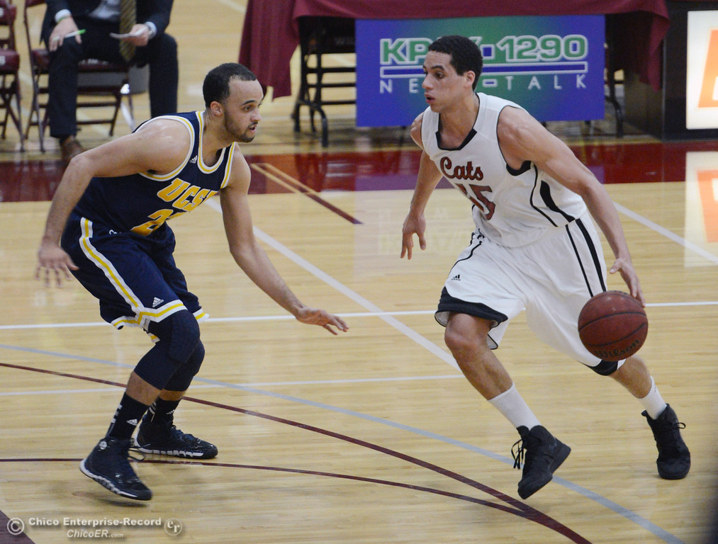 Description of . Chico State's #45 Jordan Semple (right) dribbles against UC San Diego's #23 Hunter Walker (left) in the first half of their men's basketball game at CSUC Acker Gym Friday, February 7, 2014 in Chico, Calif.  (Jason Halley/Chico Enterprise-Record)
