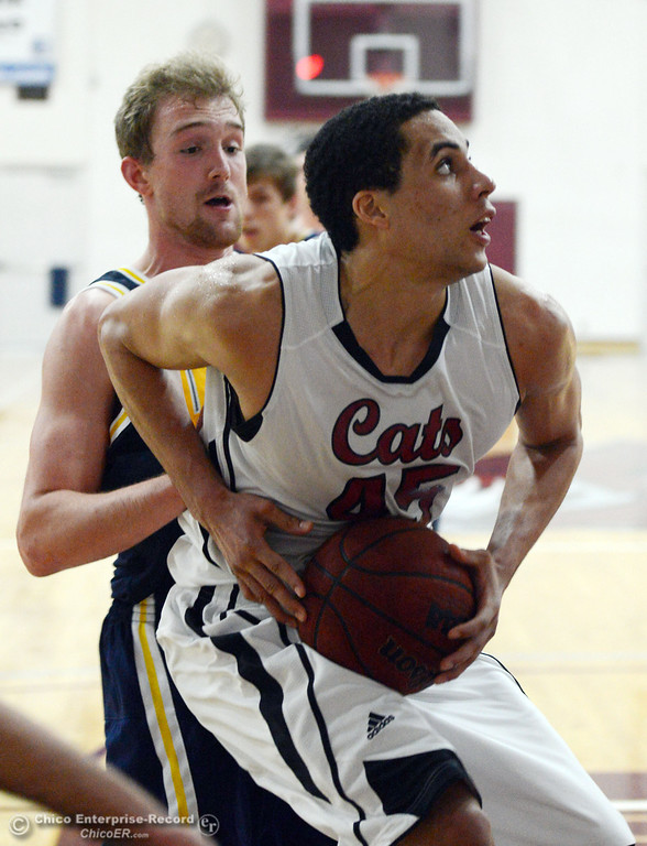 Description of . Chico State's #45 Jordan Semple (front) dribbles against UC San Diego's #14 Drew Dyer (back) in the second half of their men's basketball game at CSUC Acker Gym Friday, February 7, 2014 in Chico, Calif.  (Jason Halley/Chico Enterprise-Record)
