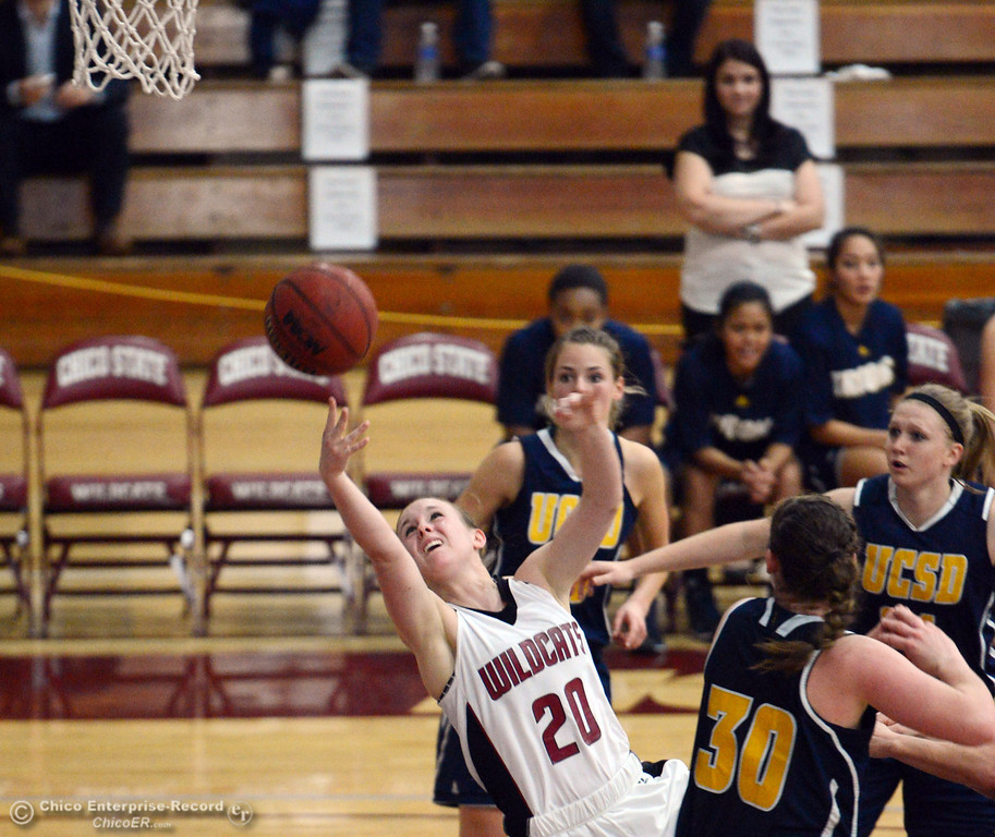 Description of . Chico State's #20 Annie Ward (left) attempts to put up a shot against UC San Diego in the first half of their women's basketball game at CSUC Acker Gym Friday, February 7, 2014 in Chico, Calif.  (Jason Halley/Chico Enterprise-Record)