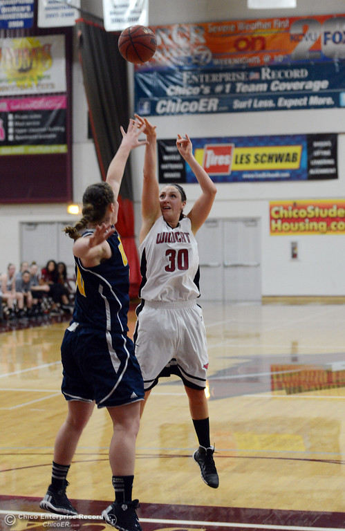 Description of . Chico State's #30 McKenzie Dalthorp (right) takes a shot against UC San Diego in the first half of their women's basketball game at CSUC Acker Gym Friday, February 7, 2014 in Chico, Calif.  (Jason Halley/Chico Enterprise-Record)