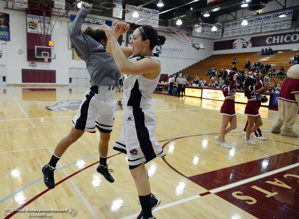 Description of . Chico State's #11 Hannah Womack (left) and #30 McKenzie Dalthorp (right) get ready against UC San Diego in the first half of their women's basketball game at CSUC Acker Gym Friday, February 7, 2014 in Chico, Calif.  (Jason Halley/Chico Enterprise-Record)