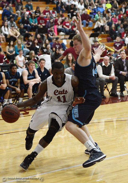 Description of . Chico State's #11 Rashad Parker (left) dribbles against Sonoma State's #24 Mike Harris (right) in the first half of their men's basketball game at CSUC Acker Gym Friday January 31, 2014 in Chico, Calif. (Jason Halley/Chico Enterprise-Record)