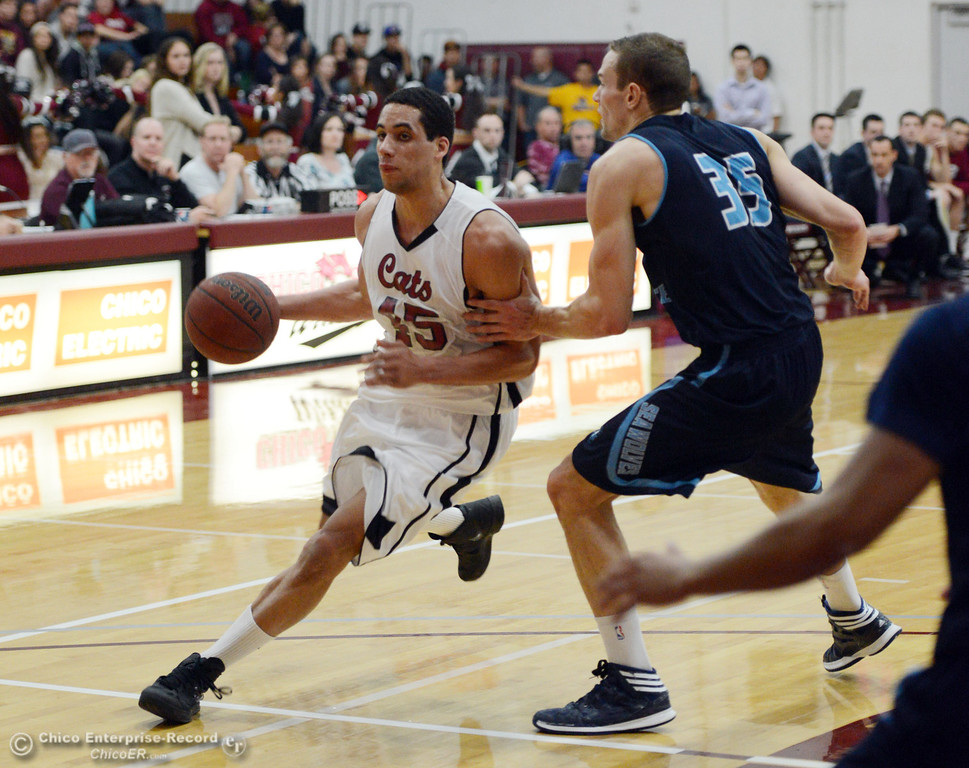Description of . Chico State's #45 Jordan Semple (left) dribbles against Sonoma State's #35 Justin Herold (right) in the first half of their men's basketball game at CSUC Acker Gym Friday January 31, 2014 in Chico, Calif. (Jason Halley/Chico Enterprise-Record)