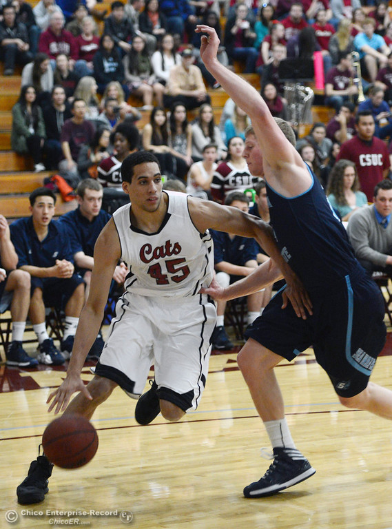 Description of . Chico State's #45 Jordan Semple (left) dribbles against Sonoma State's #24 Mike Harris (right) in the first half of their men's basketball game at CSUC Acker Gym Friday January 31, 2014 in Chico, Calif. (Jason Halley/Chico Enterprise-Record)