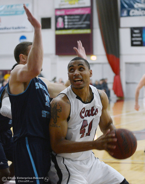 Description of . Chico State's #41 Jordan Barton (right) goes up for a shot against Sonoma State's #35 Justin Herold (left) in the first half of their men's basketball game at CSUC Acker Gym Friday January 31, 2014 in Chico, Calif. (Jason Halley/Chico Enterprise-Record)