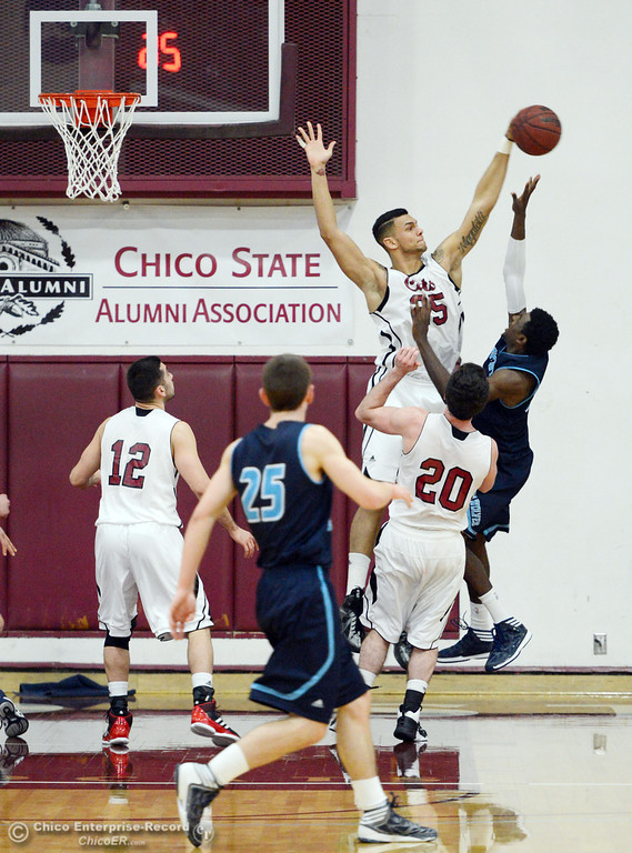 Description of . Chico State's #25 Chris Magalotti (left) blocks against Sonoma State's #33 Sterling Arterberry (right) in the second half of their men's basketball game at CSUC Acker Gym Friday January 31, 2014 in Chico, Calif. (Jason Halley/Chico Enterprise-Record)
