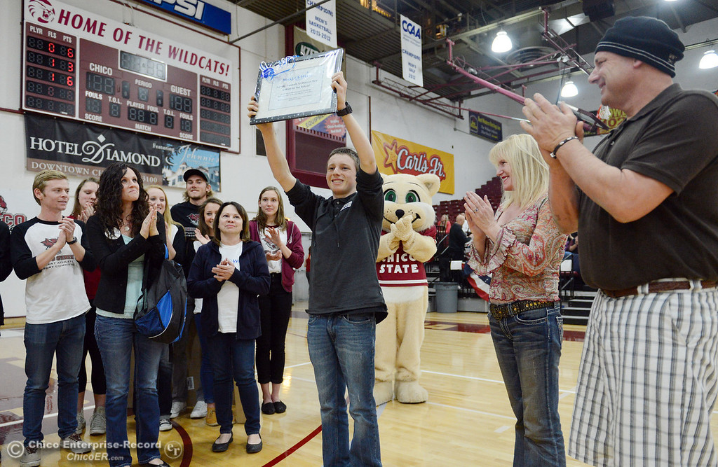 Description of . Chico State SAAC presents $5,000 check and signed Aaron Rodgers jersey to Marcus Tice as part of the Make a Wish event at halftime of men's basketball game against Sonoma State at CSUC Acker Gym Friday January 31, 2014 in Chico, Calif. (Jason Halley/Chico Enterprise-Record)