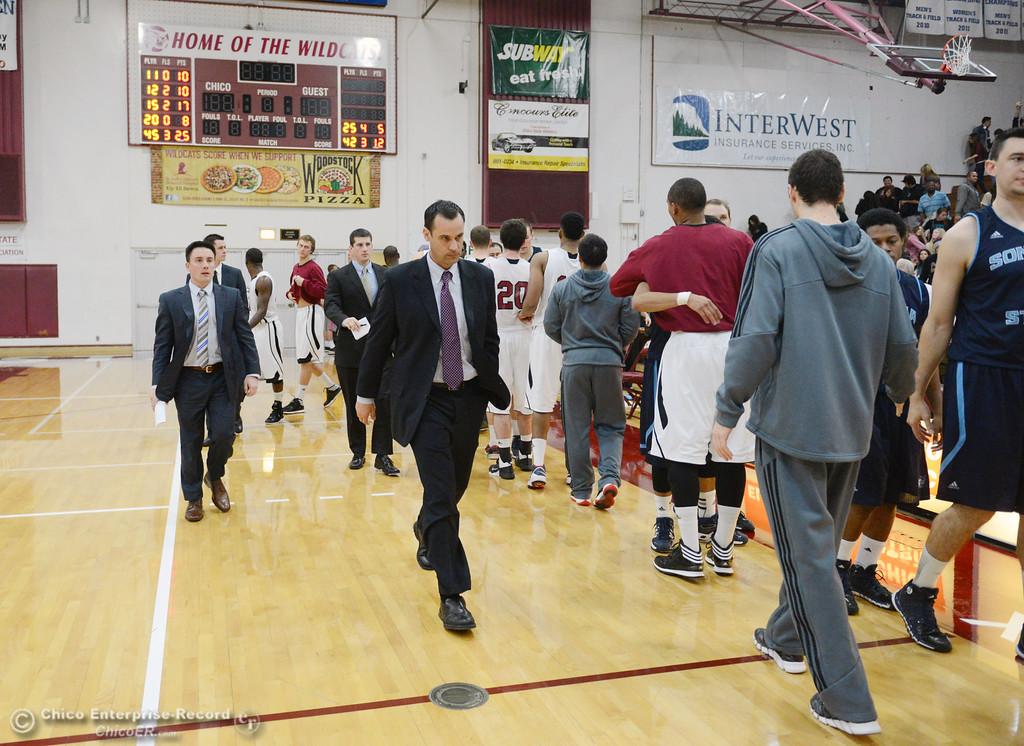 Description of . Chico State coach Greg Clink (center) walks off the court in their against Sonoma State at the end of the second half of their men's basketball game at CSUC Acker Gym Friday January 31, 2014 in Chico, Calif. (Jason Halley/Chico Enterprise-Record)