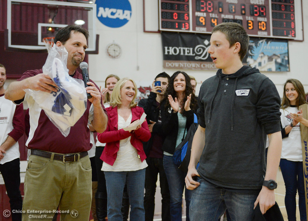 Description of . Mitch Cox (left) and Chico State SAAC presented a $5,000 check and signed Aaron Rodgers jersey to Marcus Tice (right) as part of the Make a Wish event at halftime of men's basketball game against Sonoma State at CSUC Acker Gym Friday January 31, 2014 in Chico, Calif. (Jason Halley/Chico Enterprise-Record)