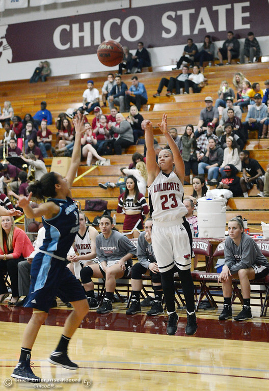 Description of . Chico State\'s #23 Jazmine Miller takes a shot against Sonoma State in the second half of their women\'s basketball game at CSUC Acker Gym Friday January 31, 2014 in Chico, Calif. (Jason Halley/Chico Enterprise-Record)
