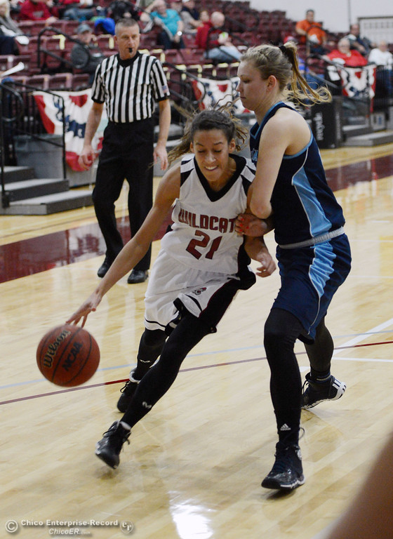 Description of . Chico State\'s #21 Courtney Hamilton (left) dribbles against Sonoma State\'s #40 Kristina Fahey (right) in the second half of their women\'s basketball game at CSUC Acker Gym Friday January 31, 2014 in Chico, Calif. (Jason Halley/Chico Enterprise-Record)